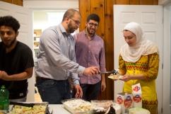 Farris Barakat serving food to break a fast during Ramadan.